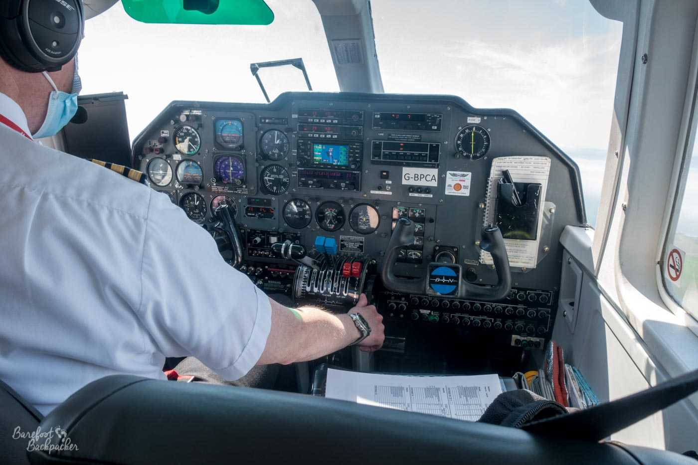 A shot taken from inside one of the inter-island aeroplanes. The view from my seat is pretty much entirely of the cockpit and the flight dashboard – it's literally the seat in front of me.