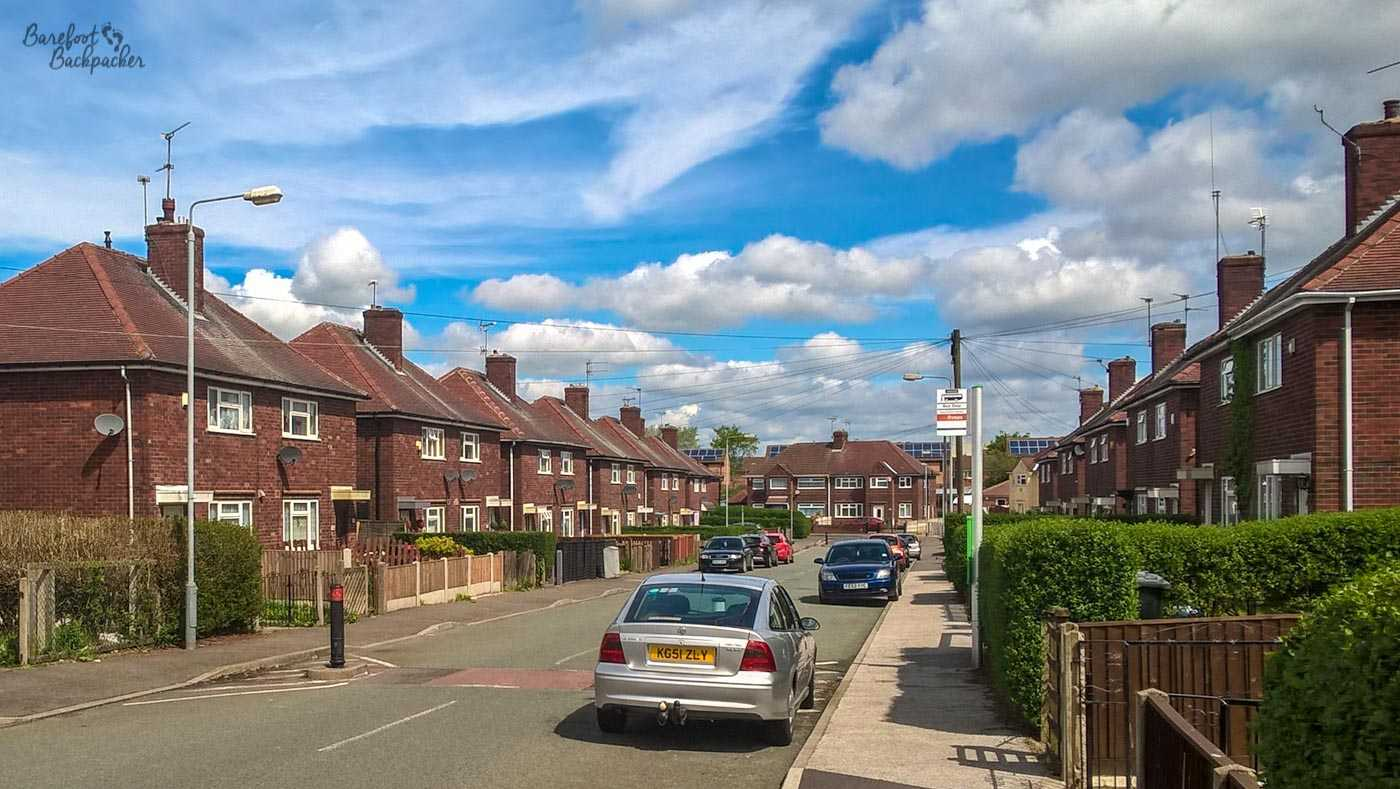A suburban street of semi-detached pseudo-terraced houses in the town of Kirkby-in-Ashfield, where I lived for 15 years (though none of the houses pictured are mine). They're brick-built, generally look quite similar with each building having two sets of windows, one at ground level and one on the upper floor, and line both sides of the narrow road.